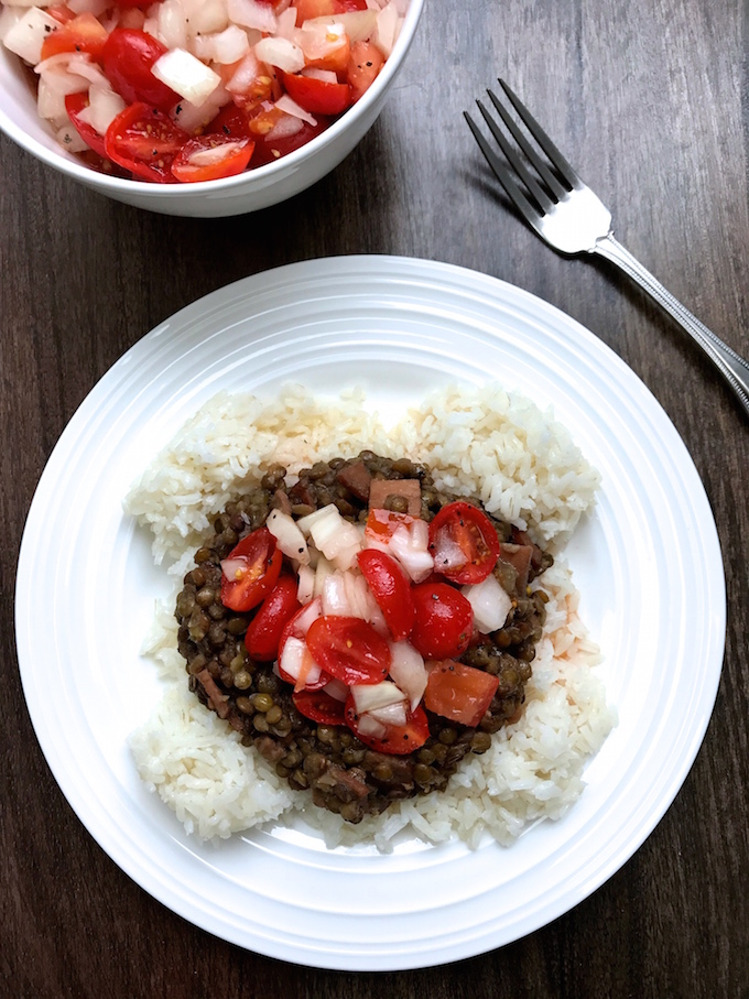 Lentils with Rice and Tomato Onion Dressing is classic Peruvian peasant food that is delicious, filling, and healthy. The lentils are served with rice then topped with a dressing made of sweet onions and tomatoes soaked in a red wine vinegar dressing which completely brightens and flavors the dish. Can be made with bacon, ham, or vegetarian. ¡Al Ataque!