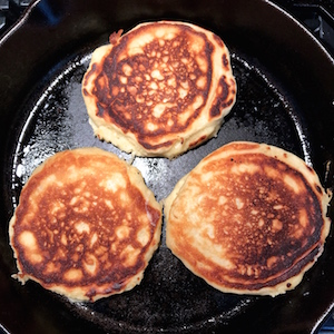 Perfect Homemade Pancakes made from scratch using simple ingredients. Takes 5 minutes to prepare resulting in delicious, fluffy pancakes with crispy edges. Perfect for breakfast, lunch, or dinner. Recipe can be doubled and these freeze and reheat well allowing you to enjoy anytime.