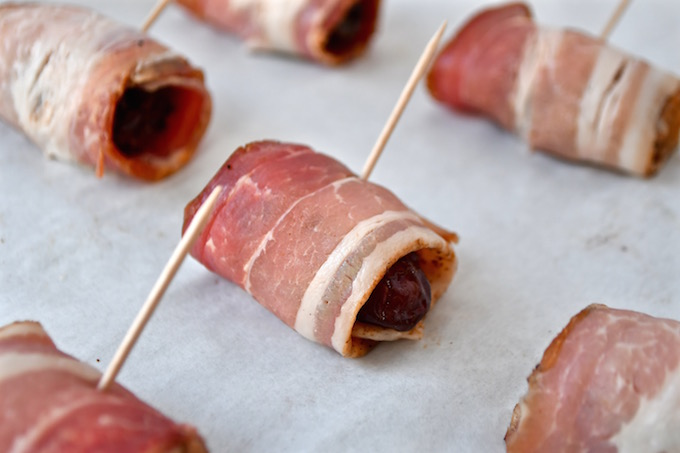 A date wrapped with spiced bacon.