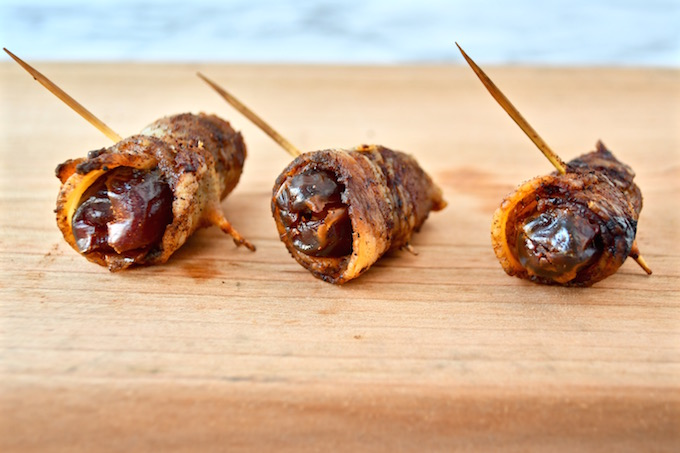 A picture of a failed attempt of Dates wrapped in bacon then spiced.