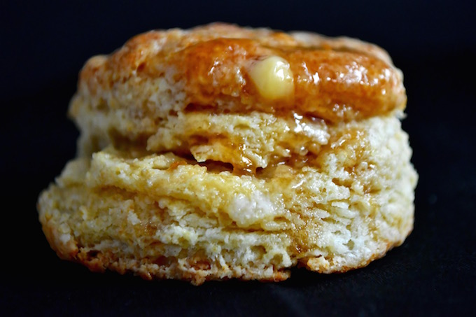 A Heavenly Buttermilk Biscuit dripping with honey and butter.