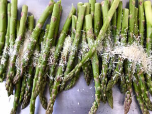 Ready to toss asparagus with ingredients.
