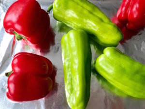 Red bell and Italian green peppers.