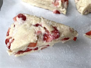 Unbaked strawberry scone on baking sheet.