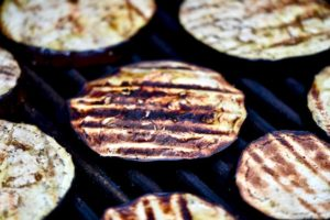 Charred eggplant on grill.