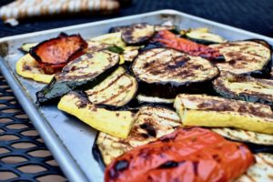 Grilled vegetables on baking sheet.