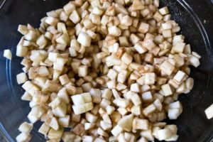 Diced apples spiced with cinnamon.
