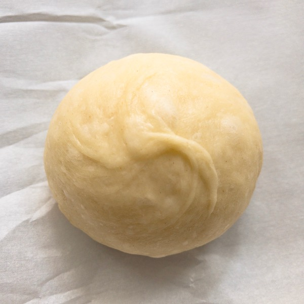A piece of dough rolled into a ball.
