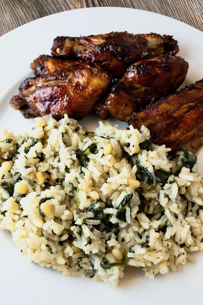 Spinach Rice and chicken wings on a plate.