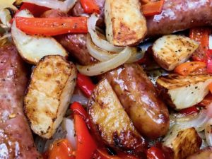 Sheet Pan Sausage Potatoes Peppers and Onions closeup.