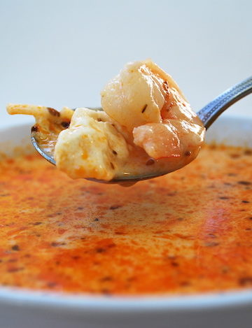 Peruvian Shrimp Soup - Chupe de Camarones is a deliciously, hearty, creamy soup loaded with shrimp, feta, and noodles. Quick and simple to make. ¡Al Ataque!