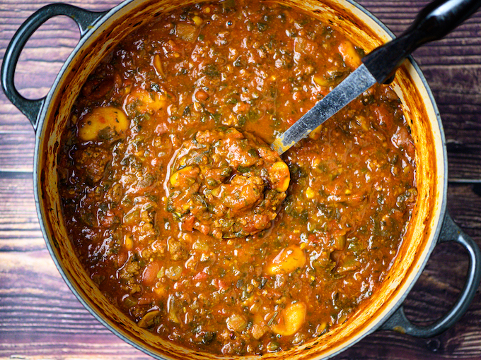 Hamburger soup in a pot with a ladle.