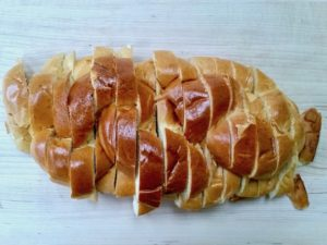 A loaf of sliced Challah bread.