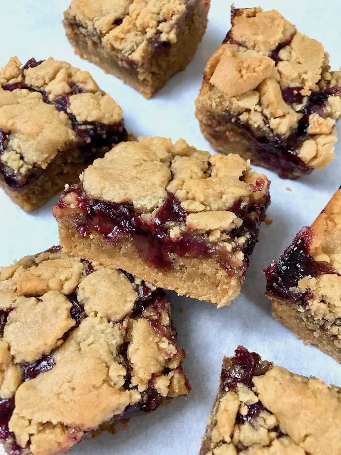 Peanut butter and jelly bars cut into squares.