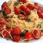 Cherry Tomatoes, basil, and loads of garlic sautéed in olive oil, then tossed with pasta water and grated cheese to create a simply delicious meal all made in under 20 minutes.