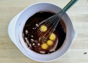 Mixing brownie batter in a bowl.
