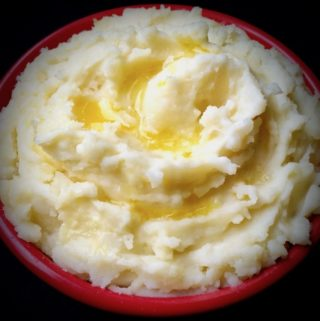 Mashed potatoes drizzled with butter.