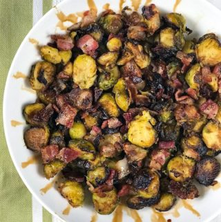 Roasted Brussels sprouts with bacon drizzled with balsamic vinegar.