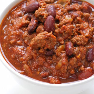 Nat Your Average Chili is a simple chili made with ground beef, beans, and loads of spices added in 2 phases. It's perfect for any party and s super hit for Superbowl. It can be prepared ahead leaving you more time to enjoy the day with your guests. Serve with your favorite condiments and...Enjoy!