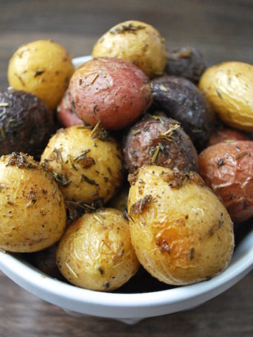 Roasted Baby Potatoes with Rosemary and Thyme is a classic combination of flavors to accompany your meal. Takes 5 minutes to prepare and uses one pan. Easy! Use a combination of whites, reds, and purples for a colorful presentation.