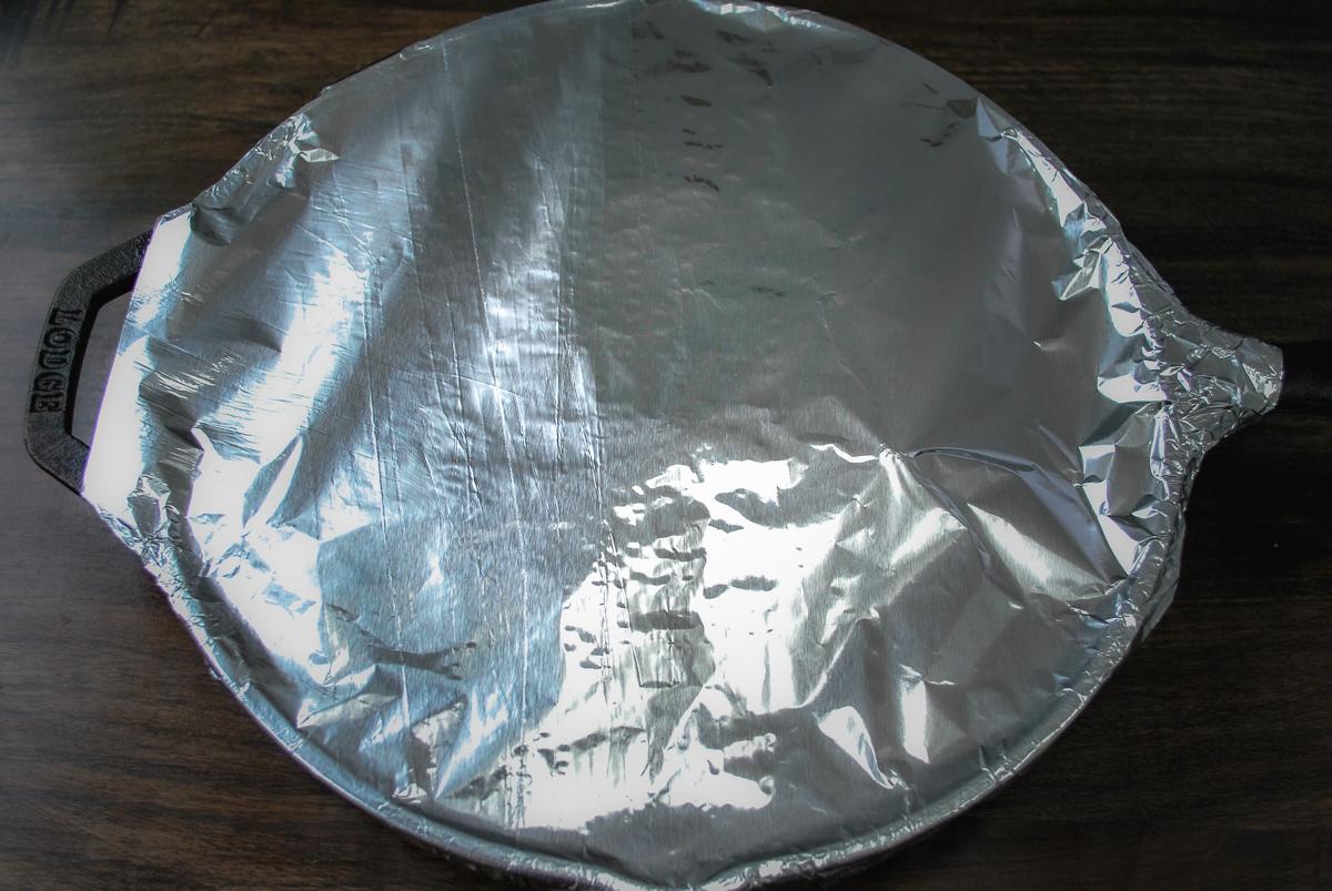 Foil covering a cast iron skillet.