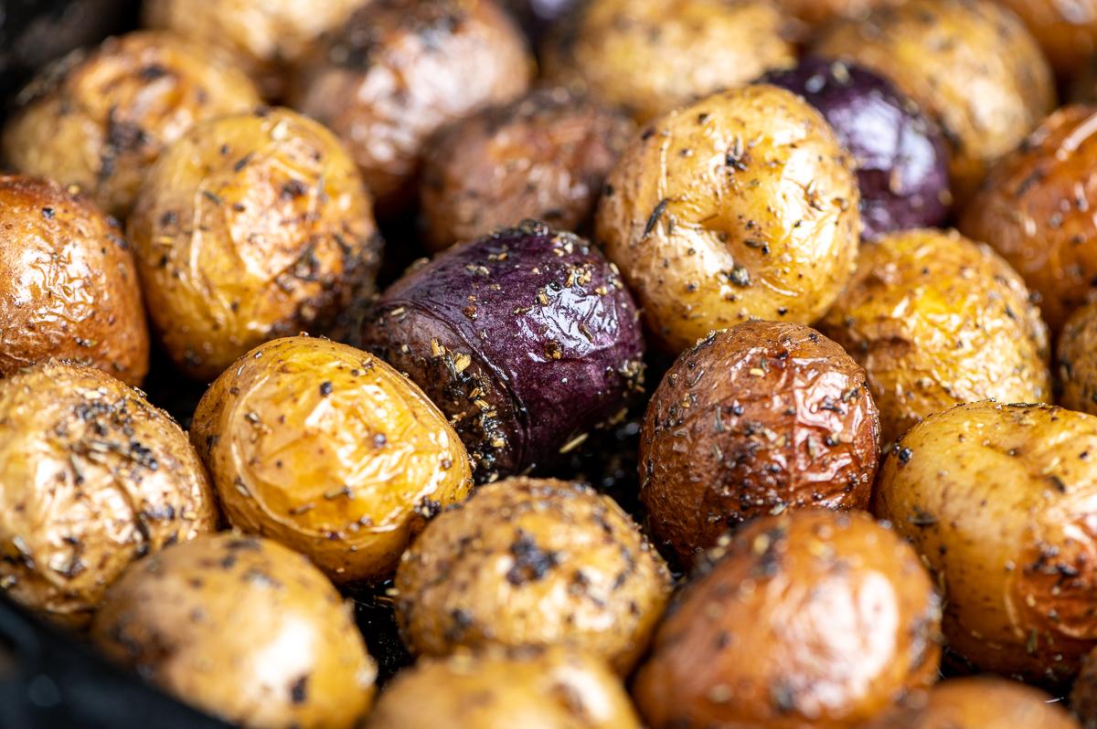 Closeup of baby potatoes seasoned and roasted.