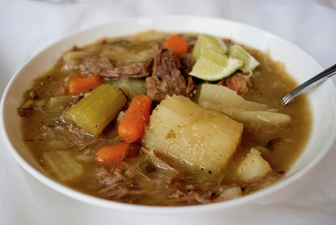 Close up of a bowl of beef cabbage soup.