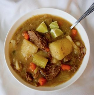 A bowl of beef cabbage soup.