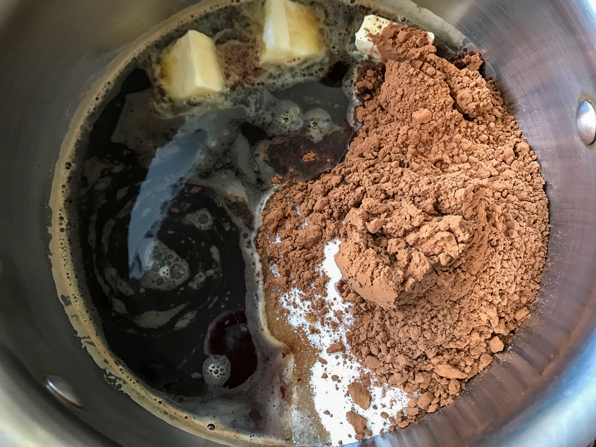 Ingredients for chocolate cake in a saucepan.