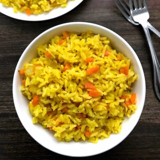 Perfect Rice Pilaf prepared two ways. A quick version flavored simply with dried spices requiring as much time as the boxed version. The second version is prepared with a mirepoix - diced onions, carrots, and celery - adding depth, flavor, and some texture. Both are delicious and simple to prepare.