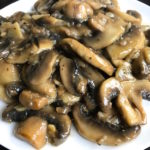 Tony's Sauteed Mushrooms - Sliced mushrooms sautéed in olive oil, flavored with garlic, then finished with a splash of wine. Makes a wonderful side or topping to just about anything.