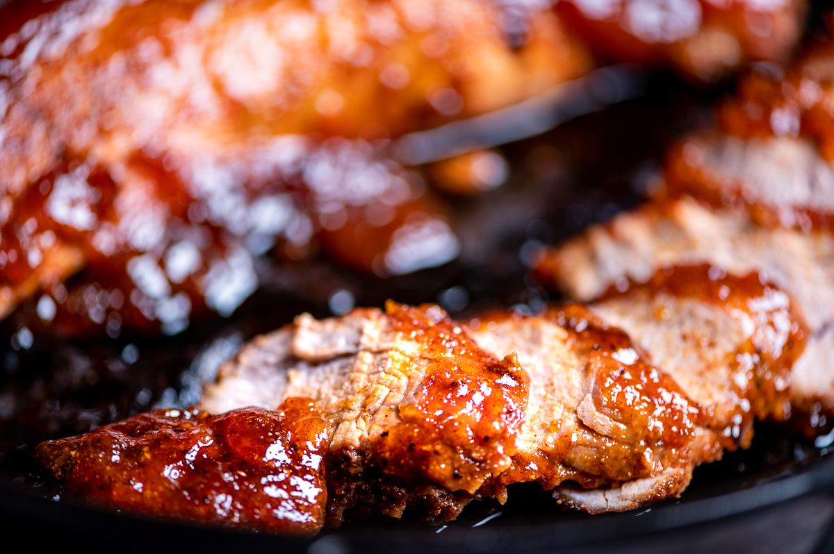 Closeup of sliced bbq pork tenderloin.