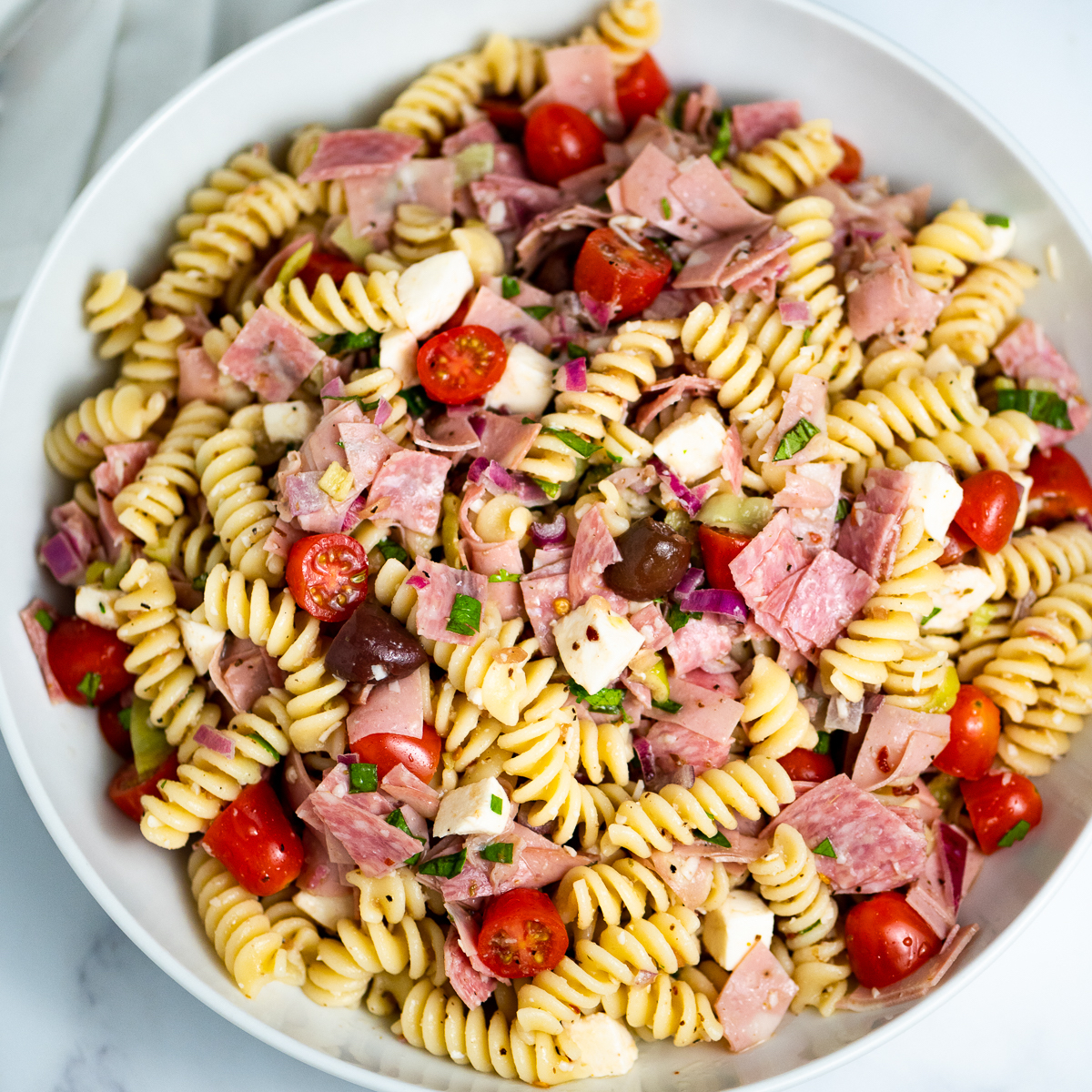 A bowl of antipasto pasta salad.