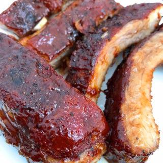 Tender, flavorful, Ultimate Oven Baked BBQ Ribs cooked low and slow. Rubbed with my Sweet and Spicy BBQ Rub and coated with my ten minute Sweet and Spicy BBQ Sauce. Perfection.