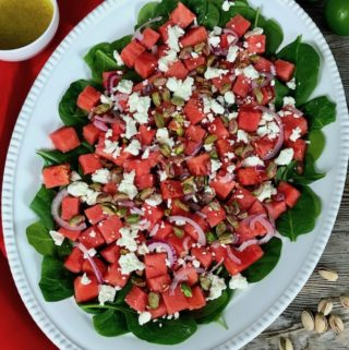 Watermelon feta salad on a white platter.