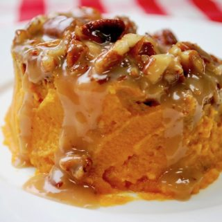 A serving of sweet potato casserole on a dish.