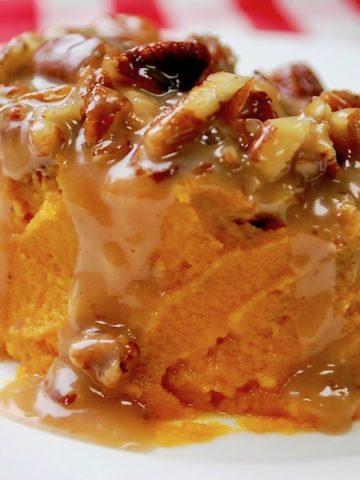 A serving of sweet potato casserole on a dish.