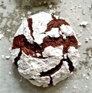 A single chocolate crinkle cookie.