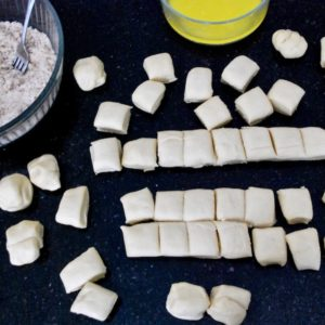Cutting pieces of dough for the monkey bread.