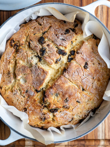 A loaf of Irish soda bread baked in a Dutch oven pot.