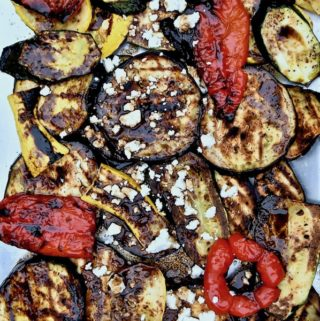Tray of grilled vegetables with feta and balsamic vinaigrette.