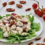 Plate of sonoma chicken salad with pecans and grapes.