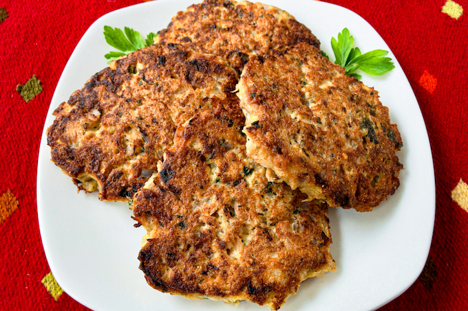 Tuna pancakes on a plate garnished with parsley.