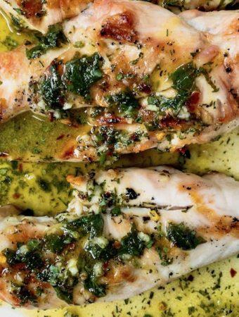 Lemon herb chicken on a platter.