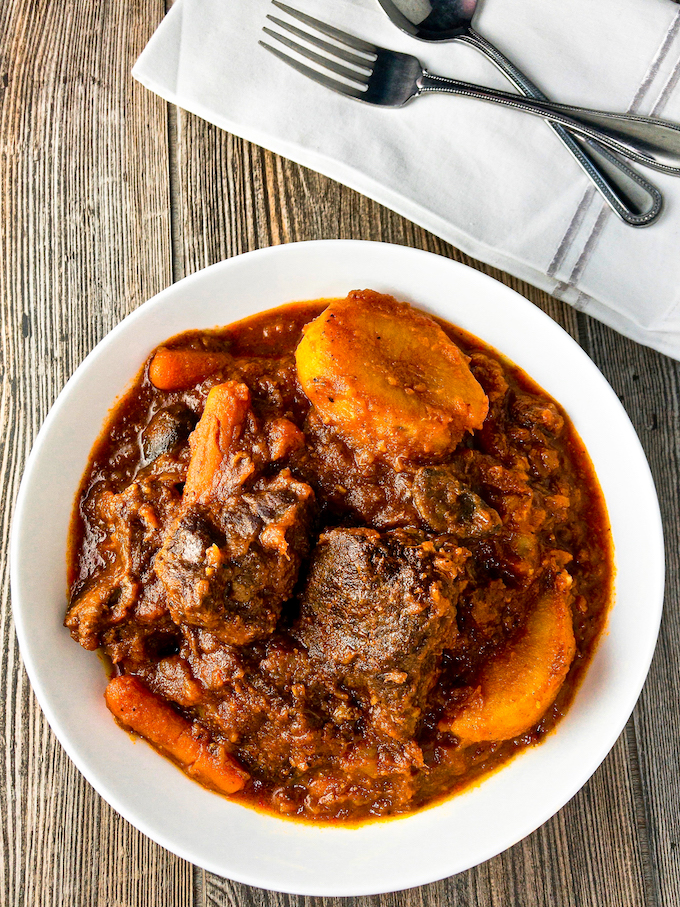 A bowl of thick hearty beef stew.