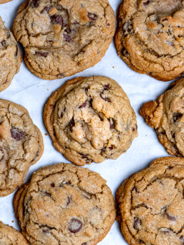 Perfectly baked chocolate chip cookies on a baking sheet.