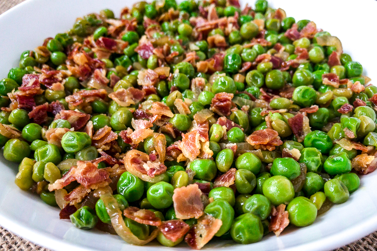 Closeup of peas and pancetta.