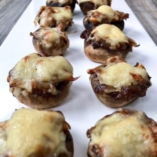 Caramelized Onion Stuffed Mushrooms on a tray.