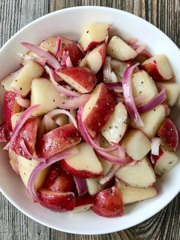 Oil and Vinegar Potato Salad in a bowl.