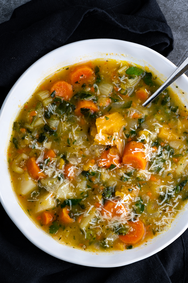 A white bowl filled with sweet potato vegetable soup.